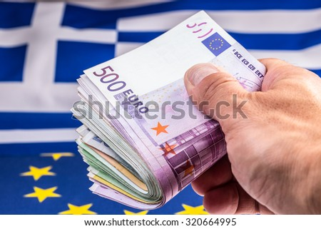 Euro coins. Euro currency. Euro money. Greece and european  flag and euro money.  Coins and banknotes European currency freely laid on the European flag - stock photo