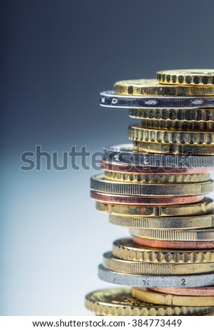 Euro coins. Euro money. Euro currency.Coins stacked on each other in different positions. Money concept. - stock photo