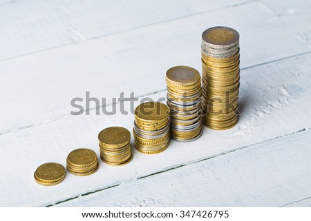 Euro coins. Euro money. Euro currency.Coins stacked on each other like rating chart. Money concept - stock photo