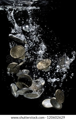 Euro coins falling down to water, metaphor of bankruptcy, crisis - stock photo
