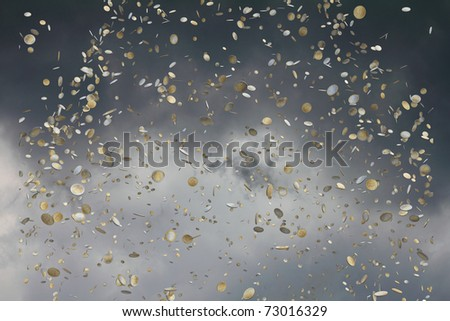 euro coins falling from the sky - stock photo