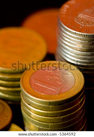 Euro coins in shadow