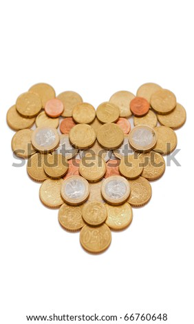 Euro coins in the shape of a heart isolated on white with little depth of field - stock photo