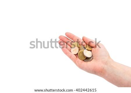 euro coins in woman's hand - stock photo