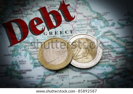 Euro coins on a map of Greece with Debt text (Greek financial crisis) - stock photo