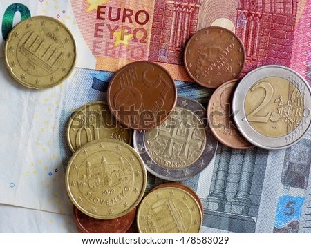 Euro coins on euro banknote