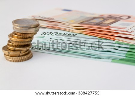euro coins on euro banknotes in the  background - stock photo