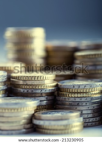 Euro coins on pile of other coins in background