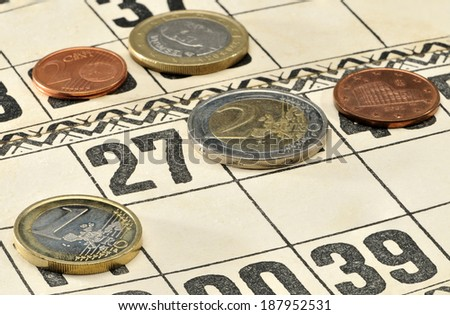 Euro coins on the cards for Russian lotto game. Macro shooting. - stock photo
