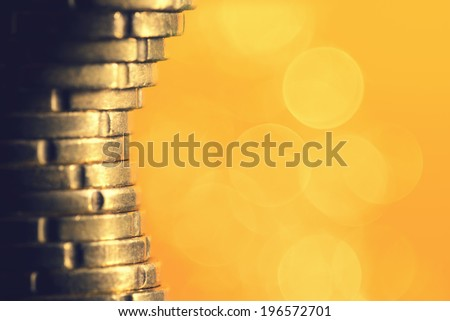Euro coins on yellow abstract background - stock photo
