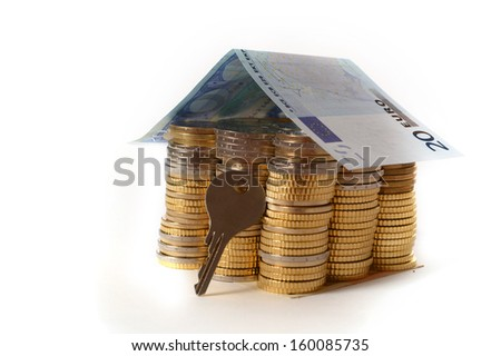 Euro Coins pile House with banknote roof and key isolated on white background - stock photo