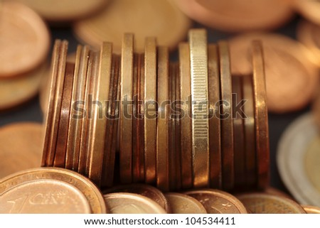 euro coins scene expressing the problems of economic crisis and the need to save - stock photo