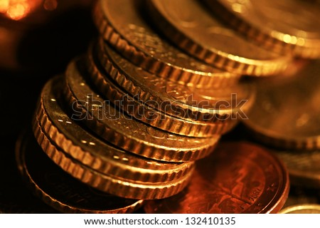 Euro coins. Very small depth of field. - stock photo