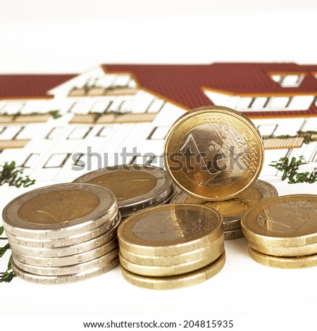 EURO coins with construction plan - stock photo