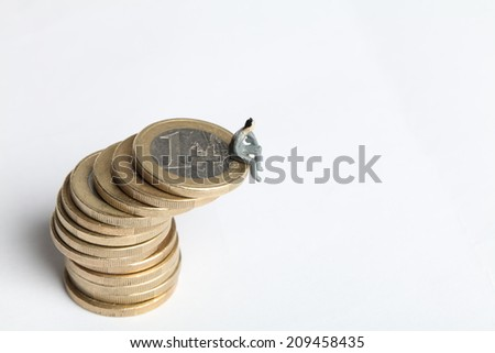 Euro coins with one euro with one person - stock photo