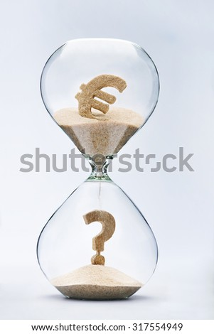 Euro crisis. Question mark made out of falling sand from dollar sign flowing through hourglass - stock photo