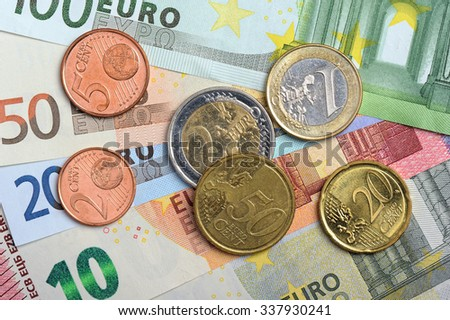 Euro currency: closeup of banknotes and coins - stock photo