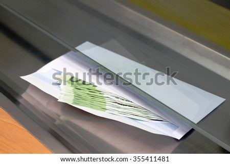 Euro Currency in a Envelope in the Bank - stock photo