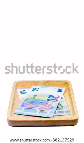 Euro currency money on trencher with white background,Focus on number 20 of banknote - stock photo
