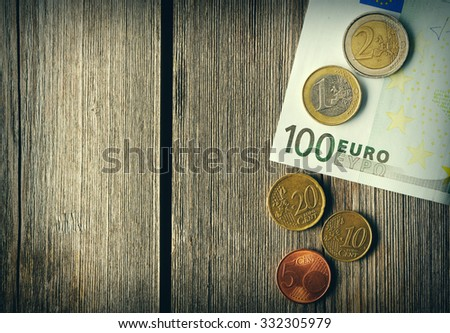 Euro currency over wooden background - stock photo