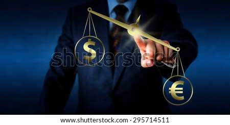 Euro currency sign is outweighing the dollar symbol on a golden pair of balances. Hand of a trader is positioning the weighing scale in mid-air by touch. Rasterized illustration combined with photo. - stock photo