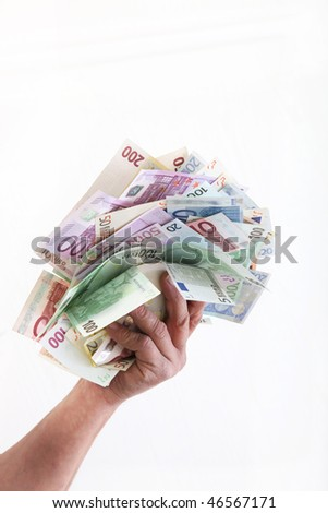 euro currency with a hand in front a white background - stock photo