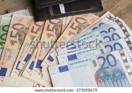 Euro (EUR) banknotes - legal tender of the European Union, close up photo - stock photo