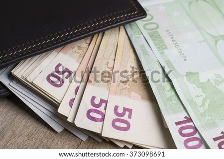 Euro (EUR) banknotes - legal tender of the European Union, close up photo