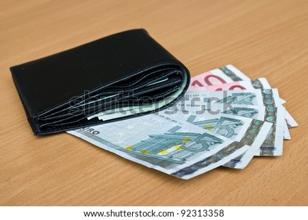 Euro, europe money, banknotes and wallet on the table - stock photo
