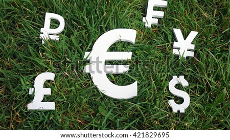 Euro exchange currency on a grass background - stock photo
