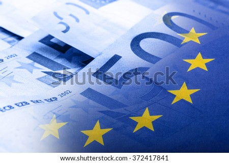 Euro flag. Euro money. Euro currency. Colorful waving european union flag on a euro money background. - stock photo