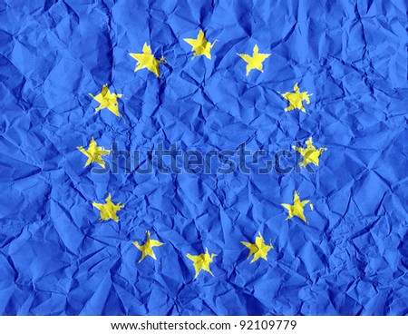 euro flag painted on wrinkled paper background - stock photo