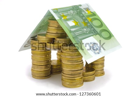 euro house built with coins and banknote - stock photo