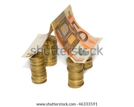 Euro house made from Euro bill with Euro coins investment - stock photo