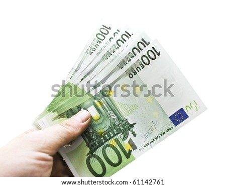 Euro in a hand isolated on white