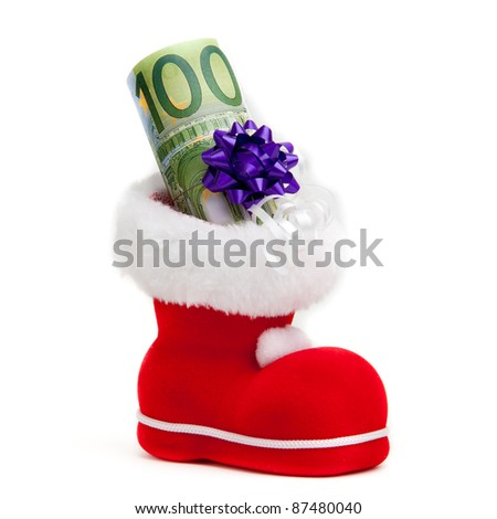 Euro in boot of Santa Claus on white background - stock photo