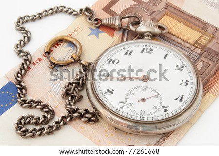 euro money, a watch and chain