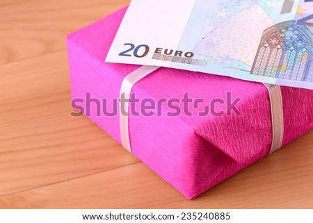 euro money and red gift box - stock photo