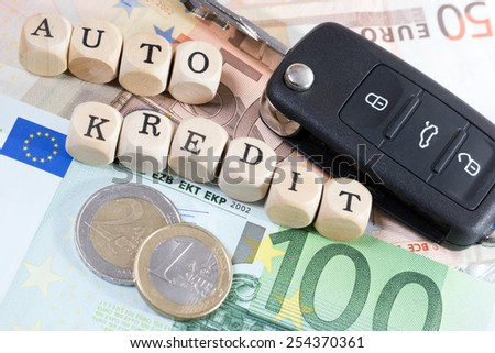 Euro Money and wood cubes with the german words car loan / car credit - stock photo