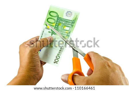 Euro money being cut in two with scissors isolated on white background - stock photo