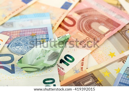 euro money boat on banknotes, abstract money concept - stock photo