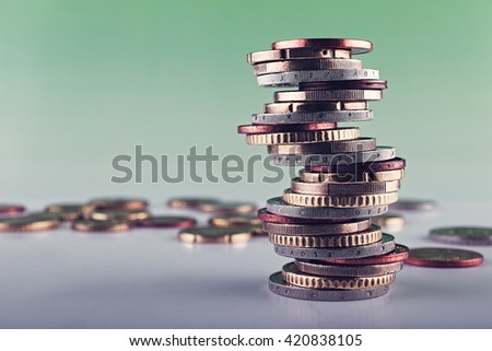 Euro money closeup coins,stacked on each other in different positions background green.   - stock photo