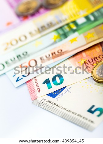 Euro money: closeup of banknotes and coins - stock photo