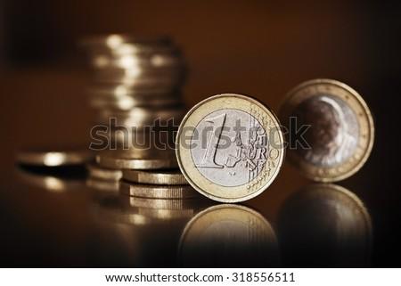 Euro Money .Euro coins on a dark background . - stock photo