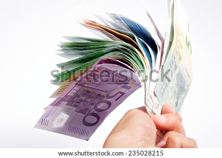 Euro money in a hand - stock photo