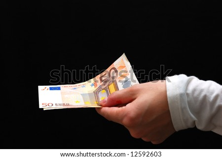 euro money in a woman hand on black background