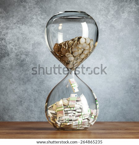 Euro Money In Hourglass (Concept Of Successful Business) stand on wooden surface behind grey wall background