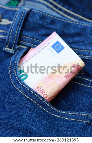euro money in jeans pocket - stock photo