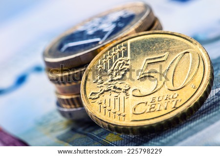 Euro money.Several euro coins and banknotes.Macro - stock photo