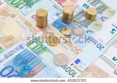 euro money stacks and banknotes on white background. - stock photo